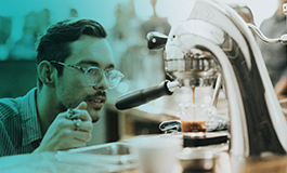 Coffee barista keeping a close eye on brewing coffee.